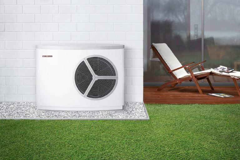 Air Source Heat Pump sited outside modern house